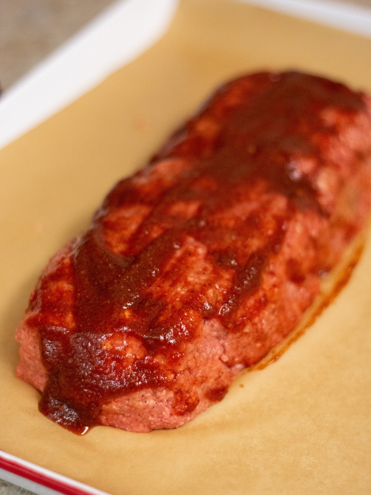 Bacon BBQ Meatloaf spread with sauce