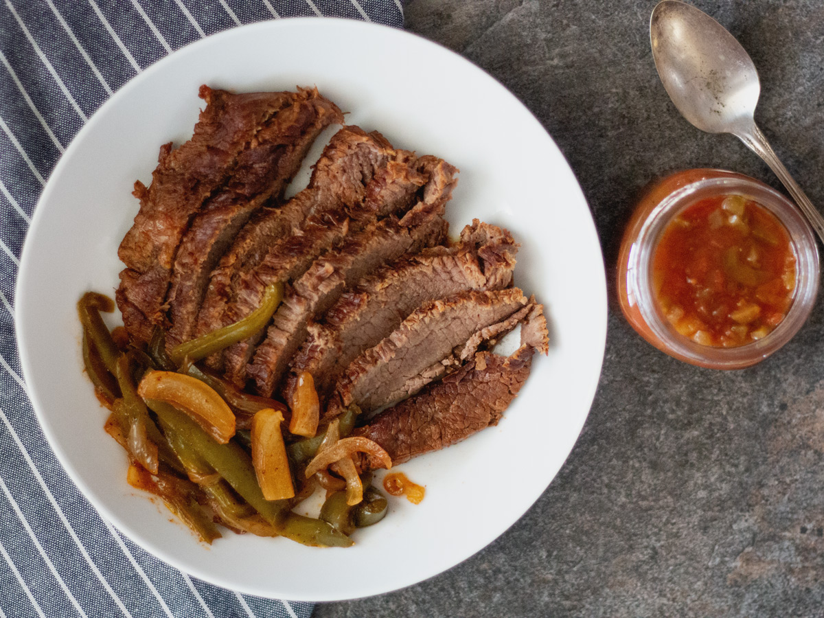 Fajita Flank Steak in the Instant Pot - Tender strips of seasoned fajita flank steak with onion and bell peppers, cooked to perfection.