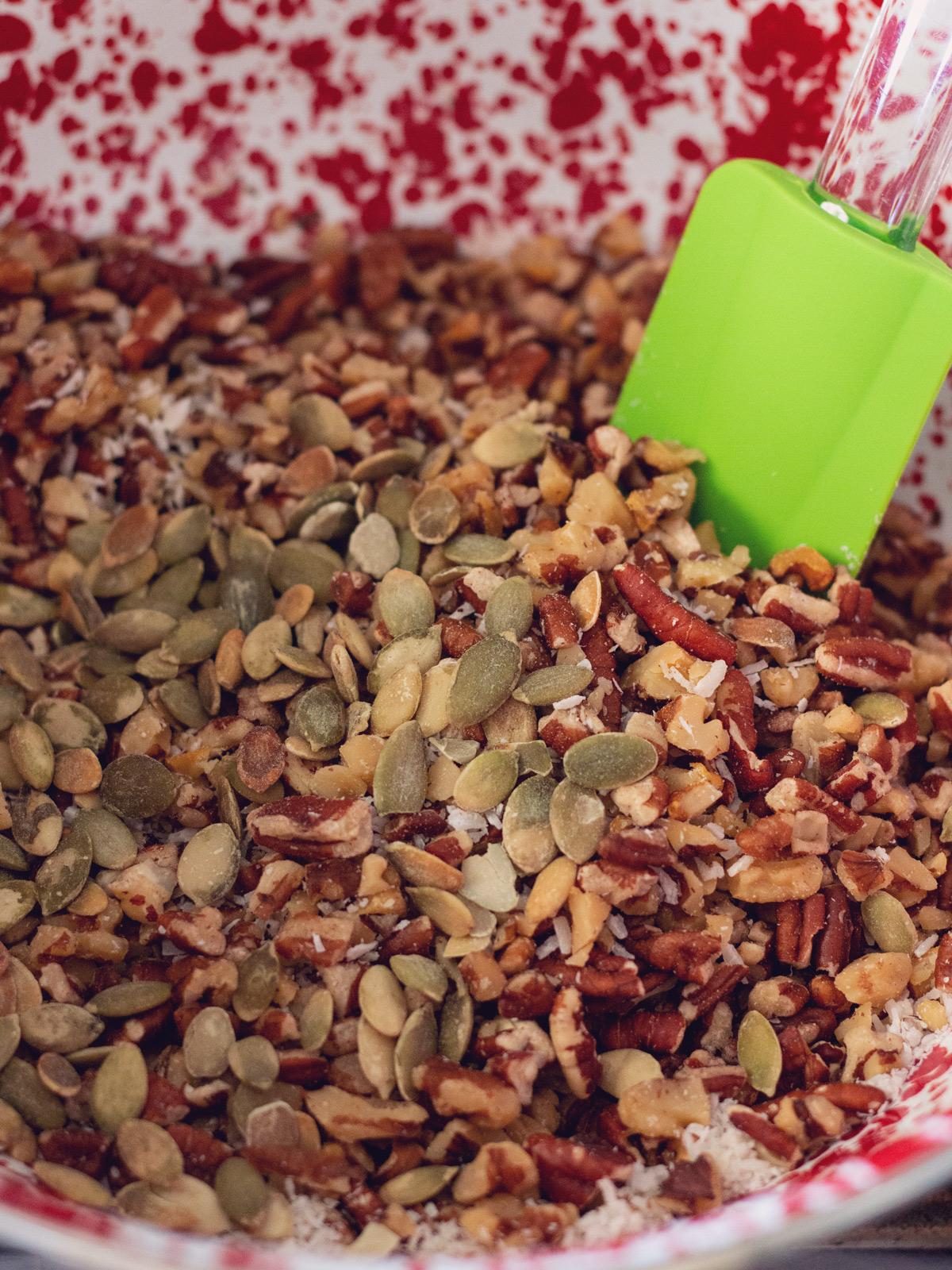 mixing granola i a bowl