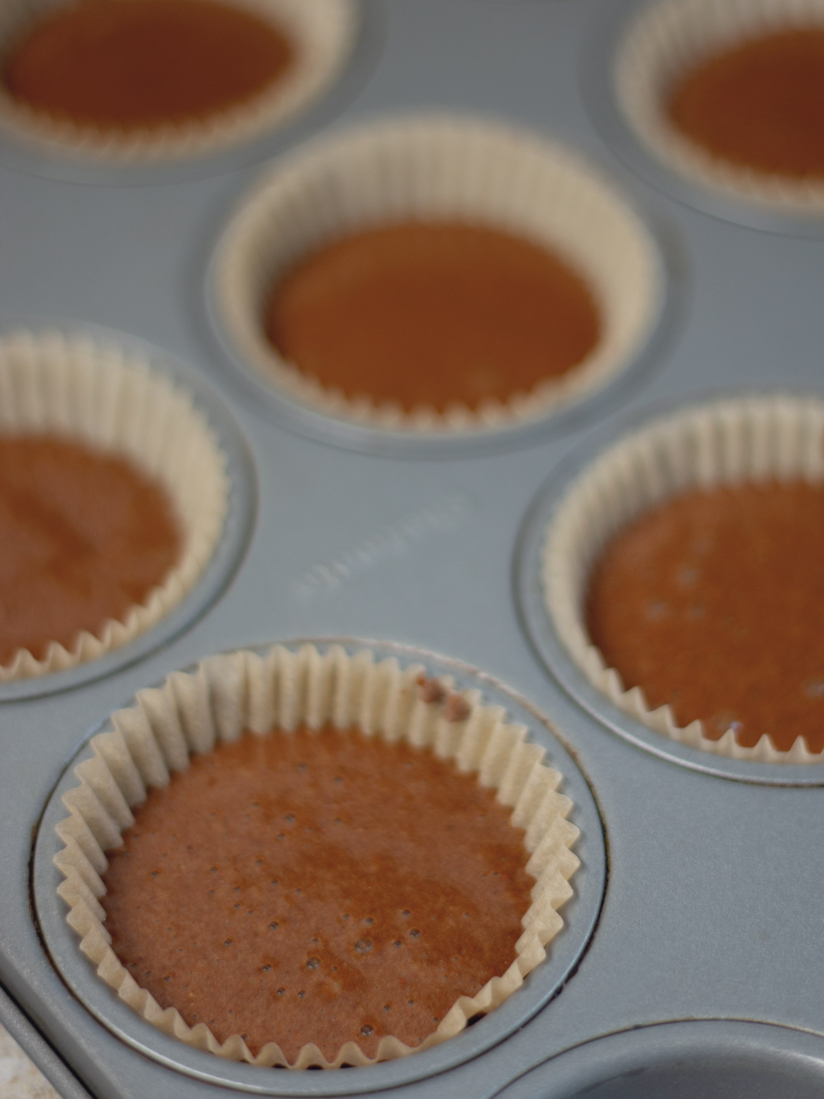 flourless chocolate muffins batter in the pan