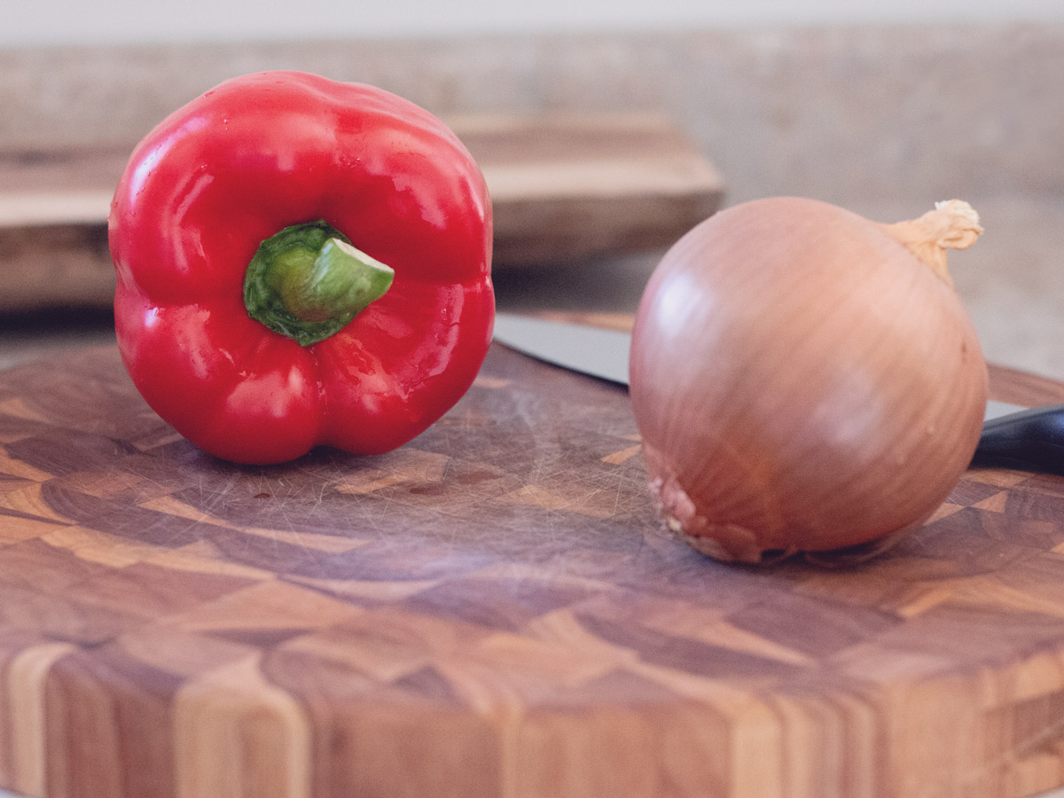 red bell pepper and onion on the cutting board