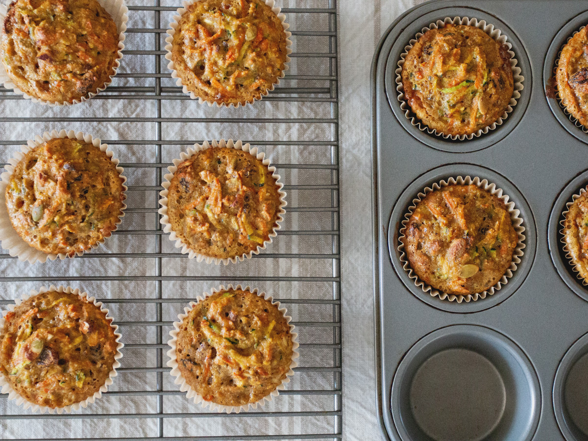Delicious Breakfast Muffins with carrot, zucchini, raisins and pecans. You will love starting your day with one of these!