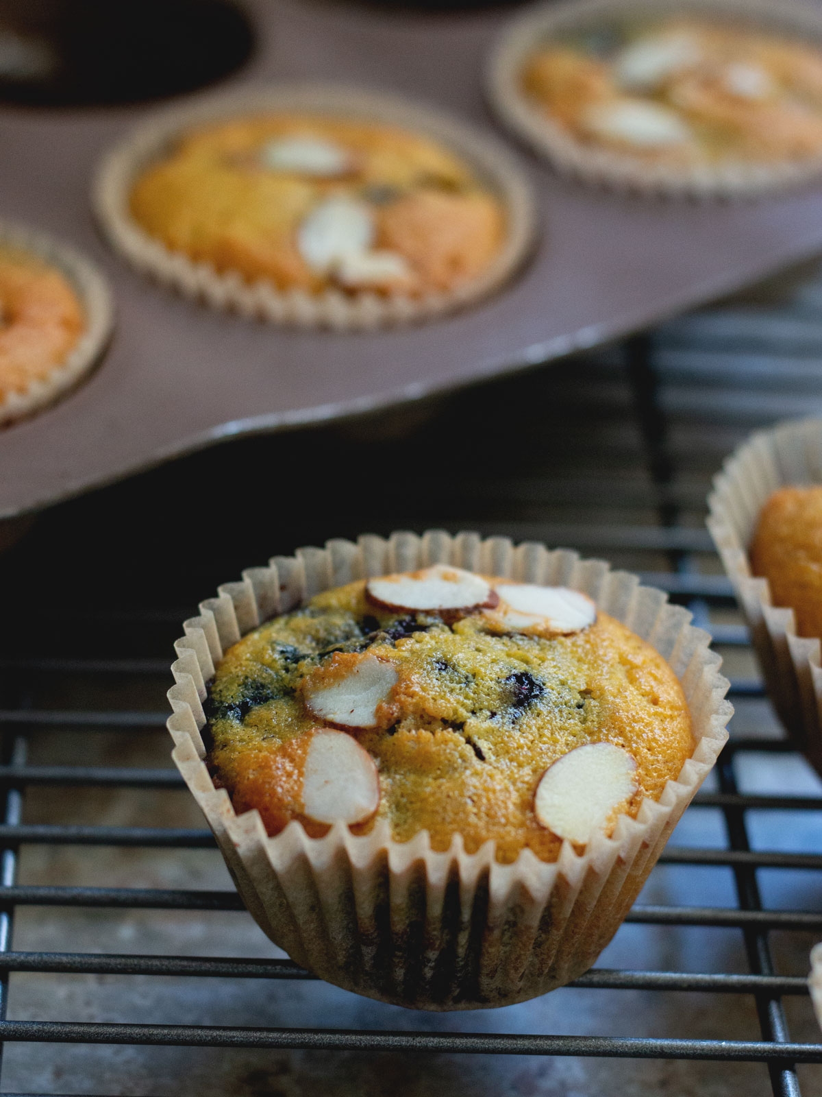 muffins being removed to a cooling rack