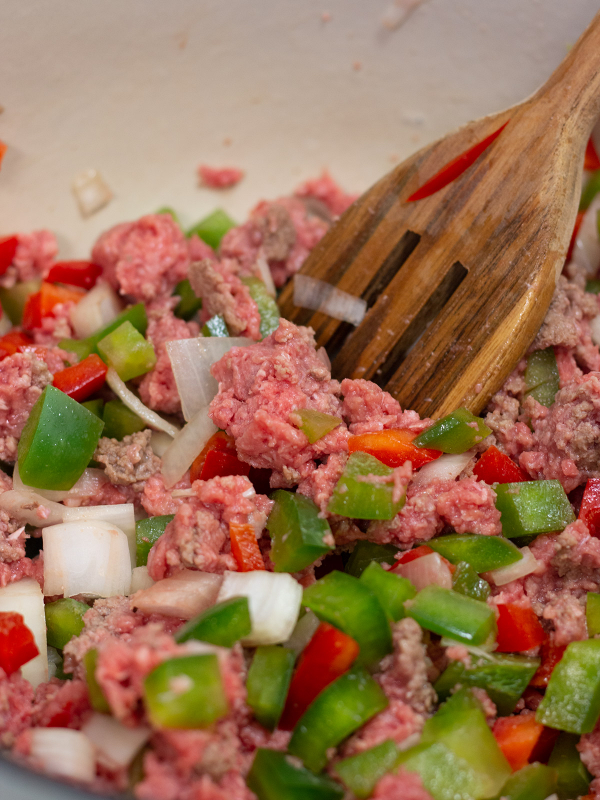ground beef, peppers and onion cooking