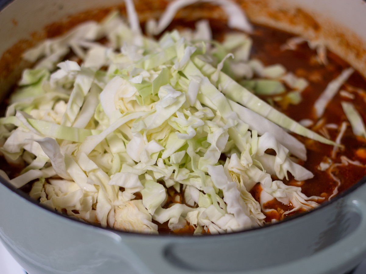 shredded cabbage in soup pot