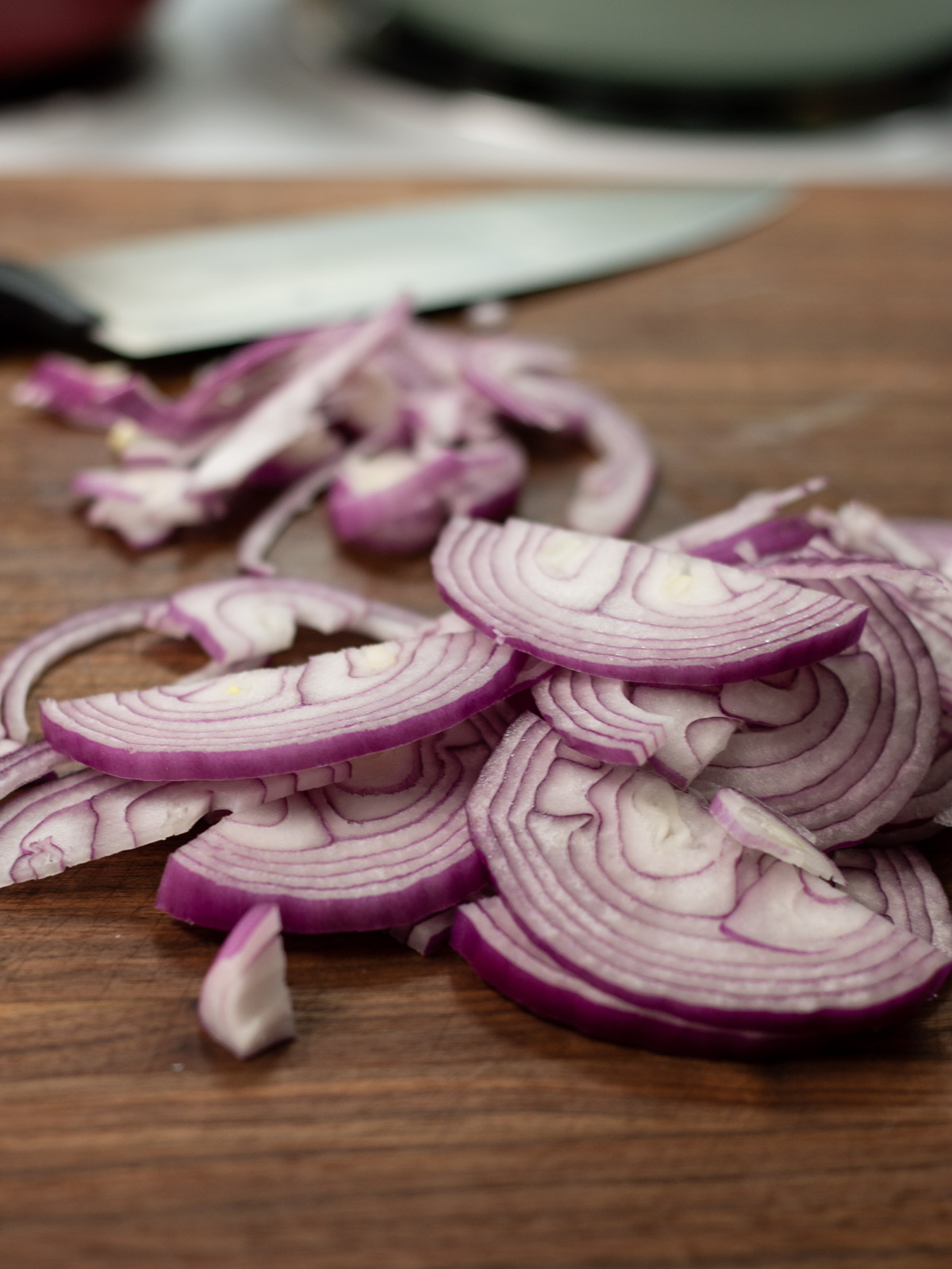 sliced red onion on cutting board